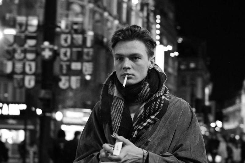 Portrait of man on street at night