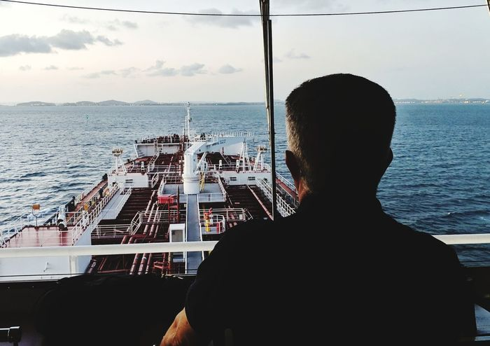 Nautical Theme Nautical Vessel Life Onboard Tanker Ship Water Cityscape Sea Rear View City Looking Through Window Sky Horizon Over Water Cloud - Sky