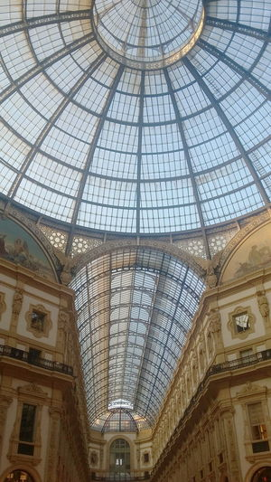 The glass of Italy's oldest active shopping mall: Galleria Vittorio Emanuele II, Milan, Italy. Architecture Shopping City Life Milano Shopping Center Tourism Gallery Interior Milan Shopping Mall Galleria Vittorio Emanuele Cupola Travel Destination Italy Dome Glass Dome Glass Roof Roof Ceiling Indoors  Architectural Feature Travel Destinations No People Architectural Design Arcade