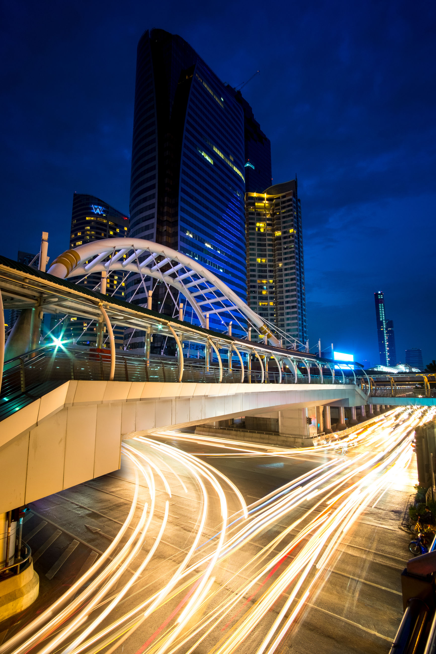 night, city, illuminated, light trail, architecture, speed, skyscraper, motion, traffic, transportation, long exposure, built structure, building exterior, modern, no people, rush hour, outdoors, urban skyline, sky