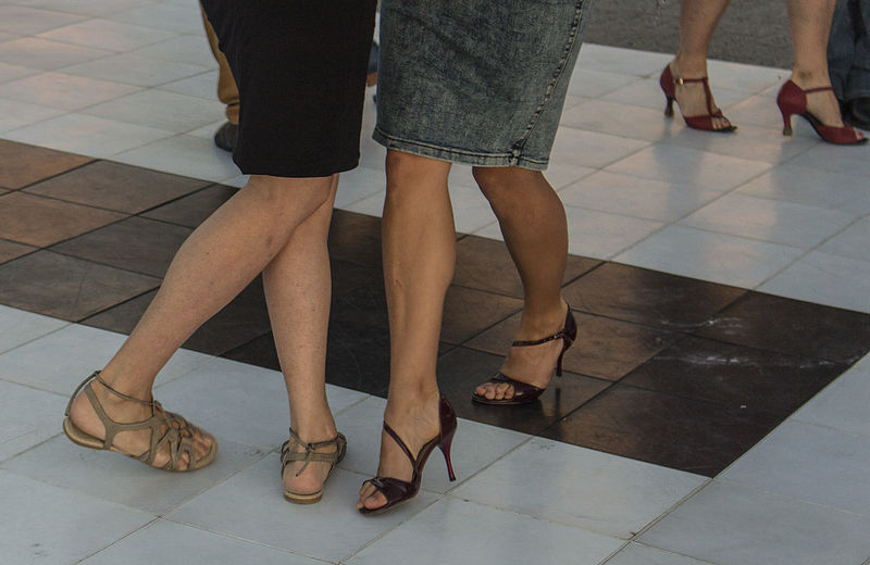 Low section of people dancing on tiled floor
