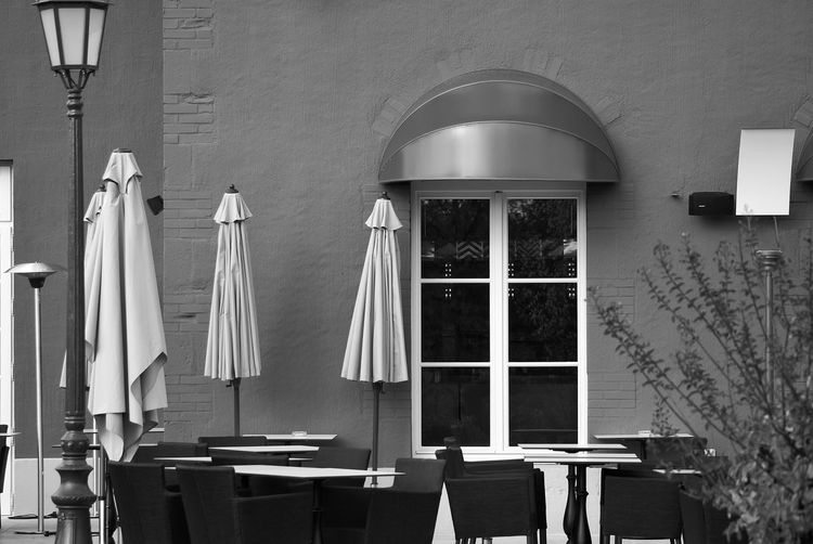 Empty chairs and tables at an outdoor restaurant