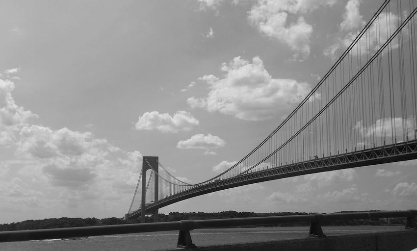 Low angle view of verrazano–narrows bridge against sky