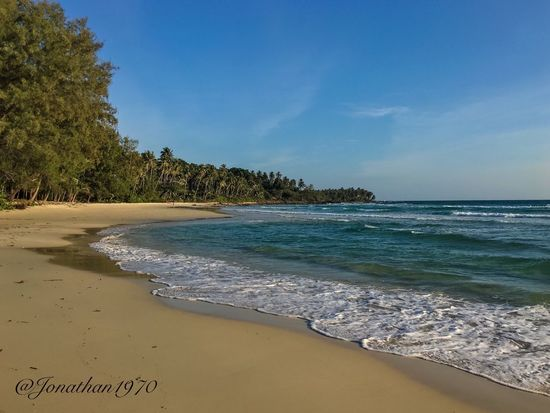 Thailand. Beach. Sea Beach Water Sand Beauty In Nature Nature Shore Scenics Horizon Over Water Sky Tree Tranquil Scene Tranquility No People Wave Outdoors Tide Thailand Tailandia EyeEm Best Shots EyeEm Nature Lover Eye4photography  Waterfront Tranquility Scenic