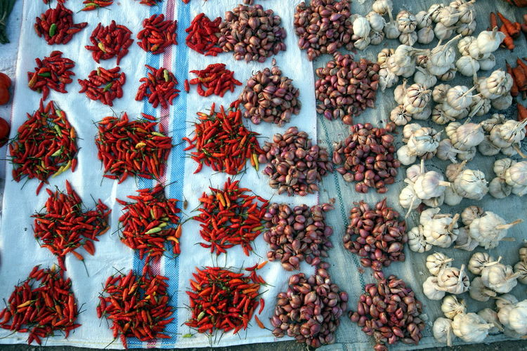 High angle view of red chili peppers at market for sale
