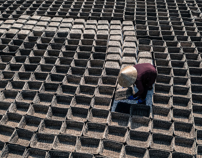 High angle view of farmer arranging baskets