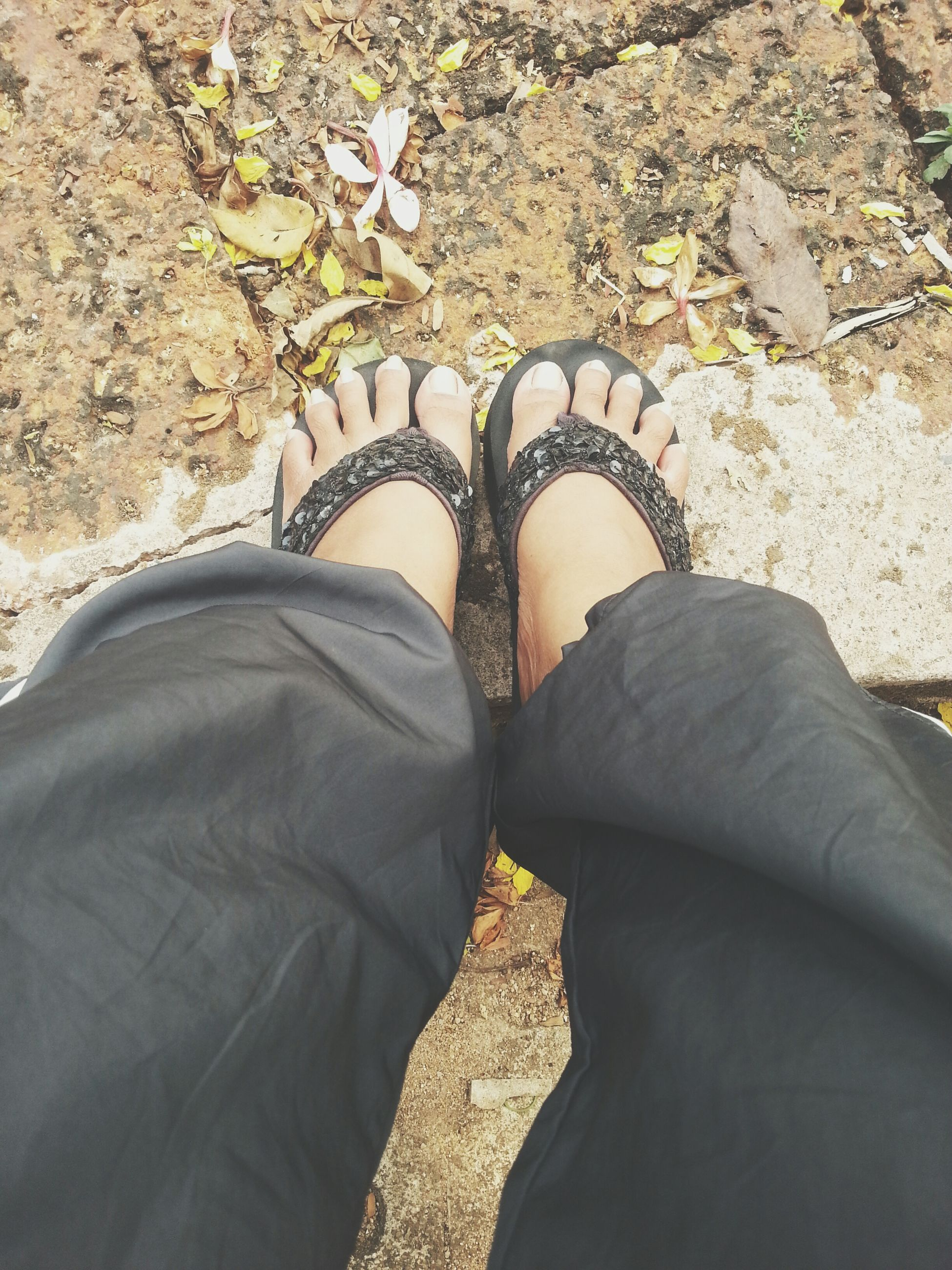 low section, person, shoe, personal perspective, lifestyles, men, high angle view, leisure activity, standing, jeans, human foot, unrecognizable person, casual clothing, outdoors, footwear, day, rock - object
