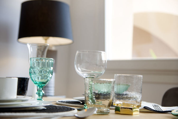 Drinking Glass Drinking Table Glass Household Equipment No People Indoors  Food And Drink Still Life Close-up Lighting Equipment Drink Focus On Foreground Transparent Selective Focus Glass - Material Absence Home Interior Water Electric Lamp Crockery Tray Day