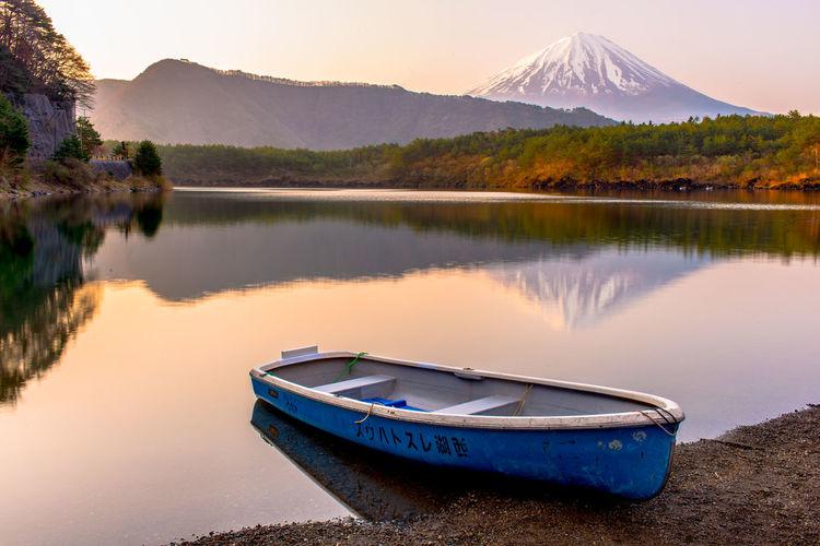 Boat Moored At Lakeshore Against Mt Fuji During Sunset