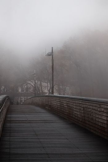 Bridge against sky during foggy weather