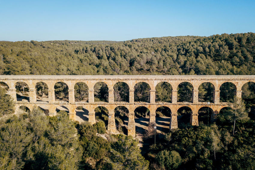 Aqueduct DJI X Eyeem Drone  The Ferreres Aqueduct Aerial Aerial View Arch Architecture Bridge Bridge - Man Made Structure Built Structure Clear Sky Day Dronephotography Landscape Nature No People Old Outdoors Plant Sky Tree