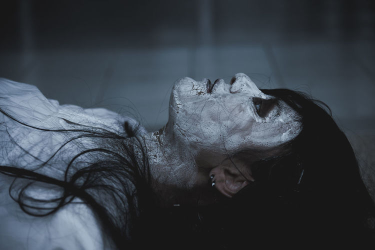 Close-up of zombie lying on floor