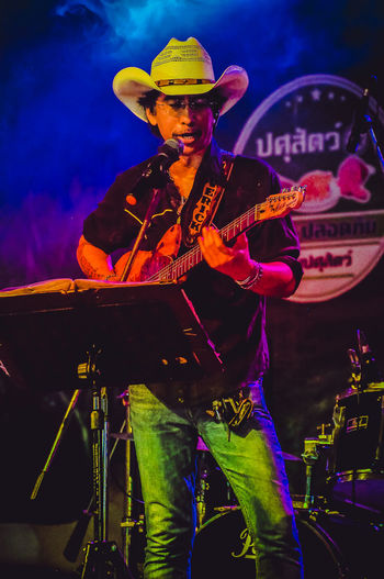 Cowboy Night Party at Nakhonsawan City, Thailand Cowboy Singer  Summer In The City The Maverick Arts Culture And Entertainment Concert Country Music Guitar Player Hat Men Music Musician One Person Showing Stage คาวบอย มือกีต้าร์ เพลงคันทรี่ カントリーミュージック ギター奏者 主唱 吉他手 歌手 音樂會