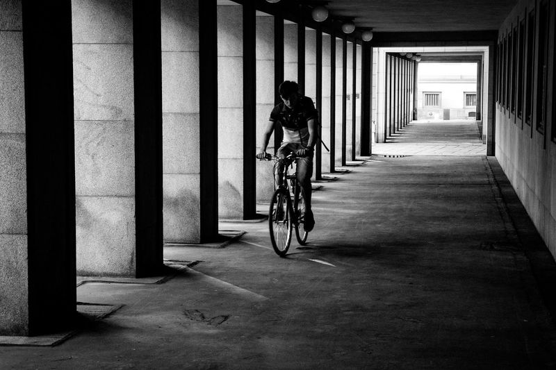 Man riding bicycle on building