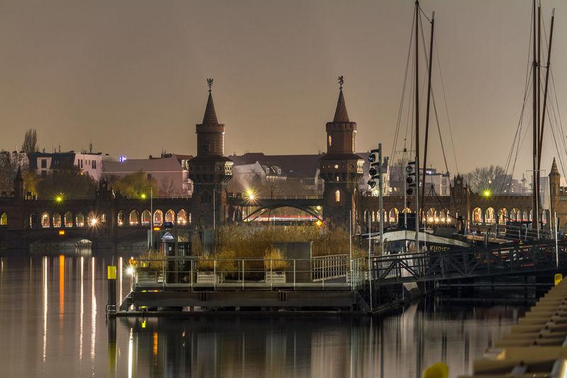 View of illuminated bridge over river against sky