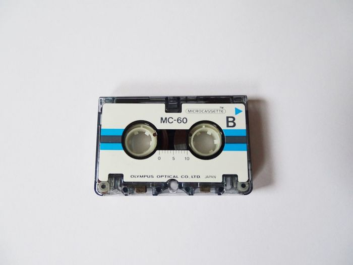 Micro cassette Tape Cassette Directly Above Audio Equipment Audio Micro Cassette Micro EyeEm Selects Close-up Technology Copy Space Indoors  No People Retro Styled Old Single Object White Background Communication Studio Shot Radio Still Life Antique Obsolete White Color