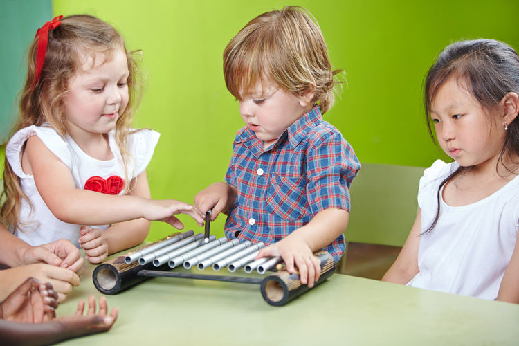 Children playing with xylophone at classroom