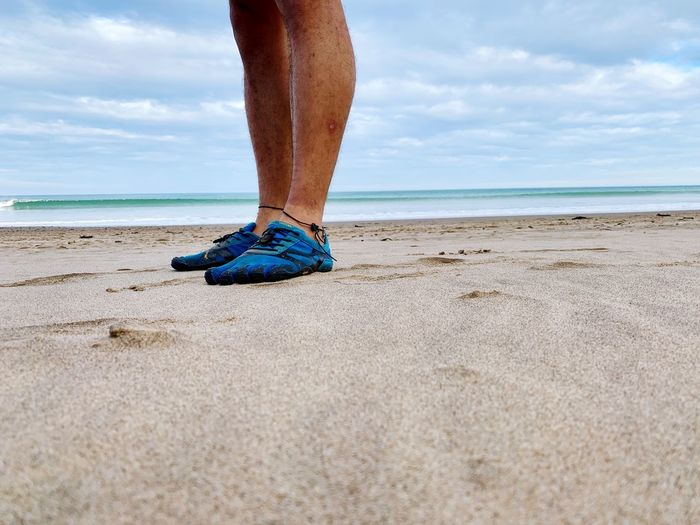 Feet on a sandy beach. Vibramshoes Vibrams Beach Sea Land Sky Low Section Water Human Leg Sand Body Part Human Body Part One Person Real People Day Cloud - Sky Horizon Over Water Outdoors Horizon