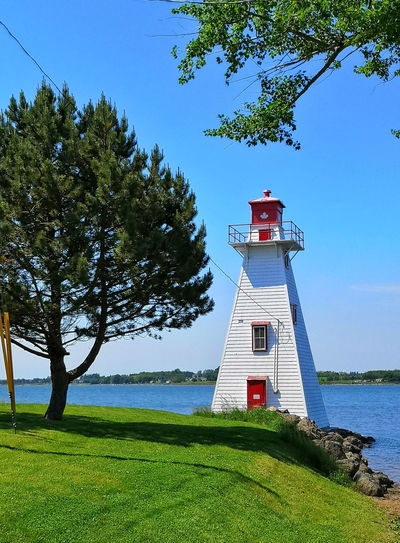 Lighthouse in Charlottetown The Architect - 2018 EyeEm Awards The Great Outdoors - 2018 EyeEm Awards The Traveler - 2018 EyeEm Awards Travel Photography Architecture Building Exterior Built Structure Day Grass Green Color Growth Guidance Land Lighthouse Nature No People Outdoors Plant Protection Safety Security Sky Tower Tree Water