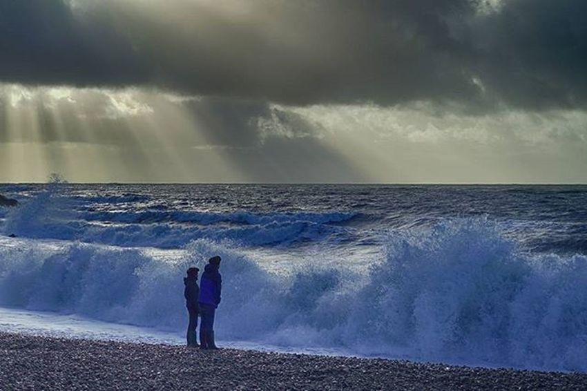 Wave watching at Chesil beach Jurassiccoast Sunshine Storm Chesilbeach Portland Lovedorset Coast Beach