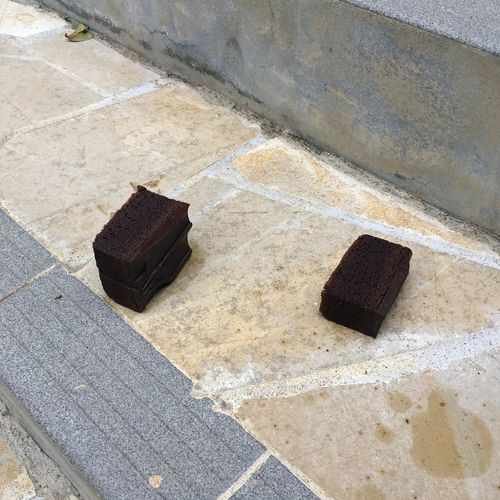 """Chocolate fudge cake on steps. """"I've fallen and can't get up"""" Chocolate Fudge Cake Steps Chocolate Cake Footpath Marble Sadness Staircase Stone Material Street"""