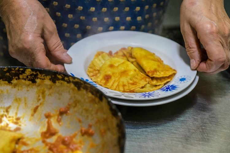 Midsection of man preparing food in plate