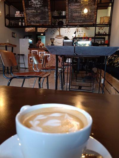 sebuah rasa hanya akan semakin nikmat jika ditemani yg org yg terpenting dihidupmu #latte Froth Art Cappuccino Frothy Drink Mocha Drink Cafe Coffee Break Food And Drink Industry Table Coffee Shop Espresso Maker First Eyeem Photo