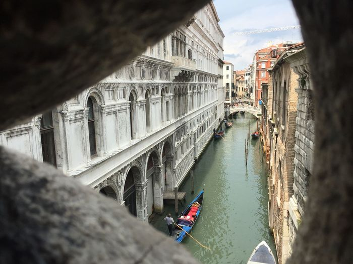 Grand canal seen through hole of bridge of sighs