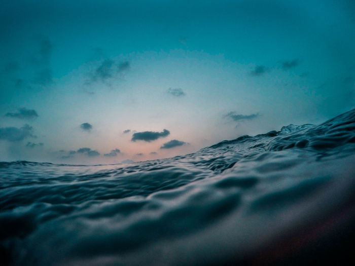 Water Surface Level Of Sea Against Sky At Sunset