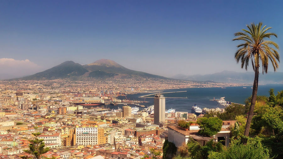 Panoramic view of the Gulf of Naples with the palaces, the commercial port, the cruise ships docked on the right and in the background the volcano Vesuvius. Beatiful Cityscape Coast Day Daylight Daytime EyeEm Gallery Gulf Italy Naples Outdoors Panorama Postcard Residential District Residential Structure Scenics Trade Port Travel Destinations Urban Landscape Vesuvius  View Volcano