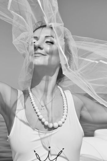 Close-up of smiling woman holding veil