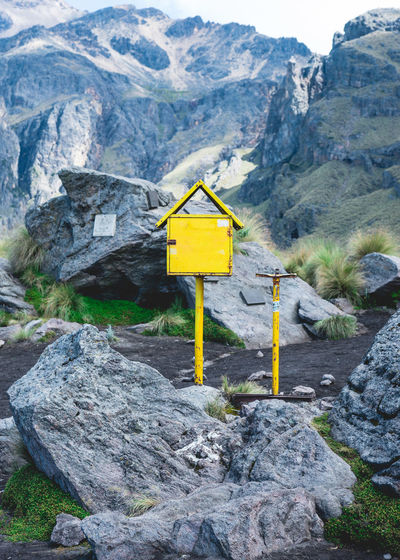 Yellow Manmade Objects In Nature Amongst ROCKY MOUNTAINS
