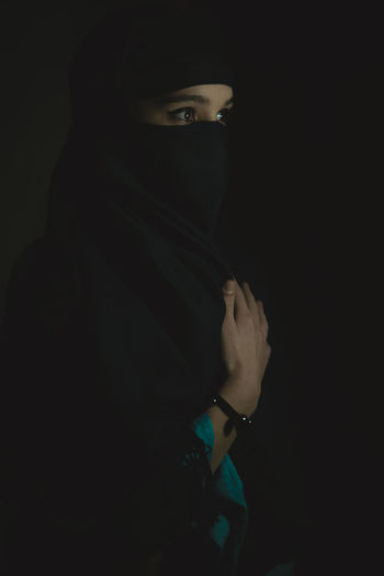 She One Person Black Background Young Adult Studio Shot Indoors  Portrait Front View Adult Women Young Women Standing Headshot Looking Lifestyles Dark Real People Clothing Human Body Part Looking Away Obscured Face