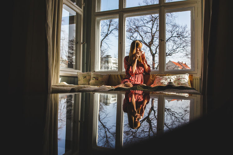 Reflection of woman in glass window