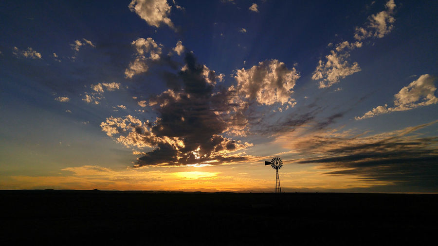 Cloud - Sky Sunset Silhouette Wind Windmill Turbine Wind Turbine Power Energy Agriculture Rural Scene Farm Ranch Countryside Plains Prairie Tranquility Dramatic Sky Environment Tranquil Scene Sky Land Horizon Distance