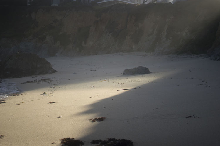 light on the beach Land Nature Tranquility Beauty In Nature No People Water Scenics - Nature Tranquil Scene Beach Sand Day Outdoors Landscape Rock Non-urban Scene Environment Mountain Solid Climate Arid Climate