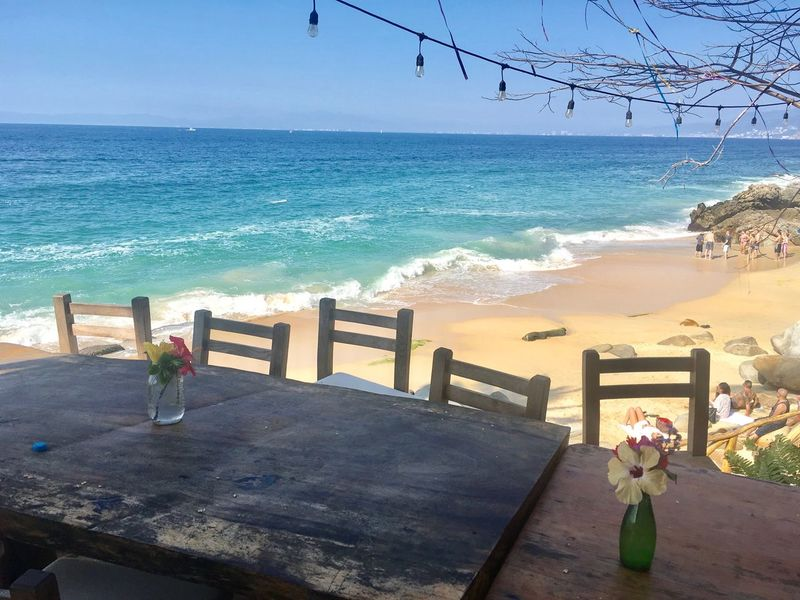 Beach table SeaView!! Seaviews Seascape Blue Sea And Blue Sky Dining Outside Dining Chairs Dining Table Al Fresco Al Fresco Dining Beachphotography