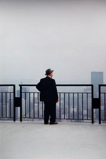 Full length of man standing against railing
