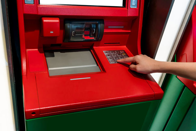 Hand of Asian woman pressing digit buttons on red ATM machine. Economy Red Screen Statement Withdrawing Cash Atm Card Cash Credit Deposit Digital Digits Electronics Industry Finger Hand Human Body Part Money Password Pin Protection