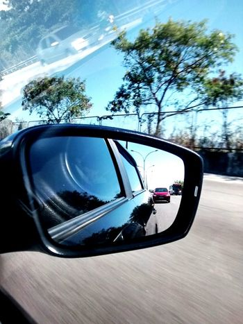 Car Transportation Mode Of Transport Tree Driving Land Vehicle Road Side-view Mirror Vehicle Mirror Road Trip Day No People Outdoors Sky