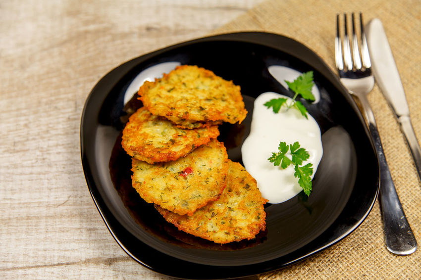 Potato pancakes with sour cream and parsley on a wooden table Homemade Meal Potato Ukrainian  Vegetarian Breakfast Close-up Eating Utensil Food Food And Drink Fork Freshness Fried Garnish Healthy Eating Herb High Angle View Indoors  Kitchen Utensil No People Plate Potato Pancake, Ready-to-eat Sackcloth Serving Size Still Life Table Table Knife Temptation Vegetable Wellbeing Wood - Material