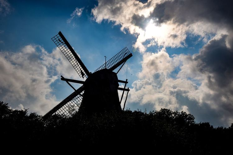 Alternative Energy Environmental Conservation Renewable Energy Wind Power Fuel And Power Generation Windmill Wind Turbine Cloud - Sky Sky Traditional Windmill Low Angle View Outdoors Industrial Windmill Silhouette No People Tree Nature Technology Day Rural Scene