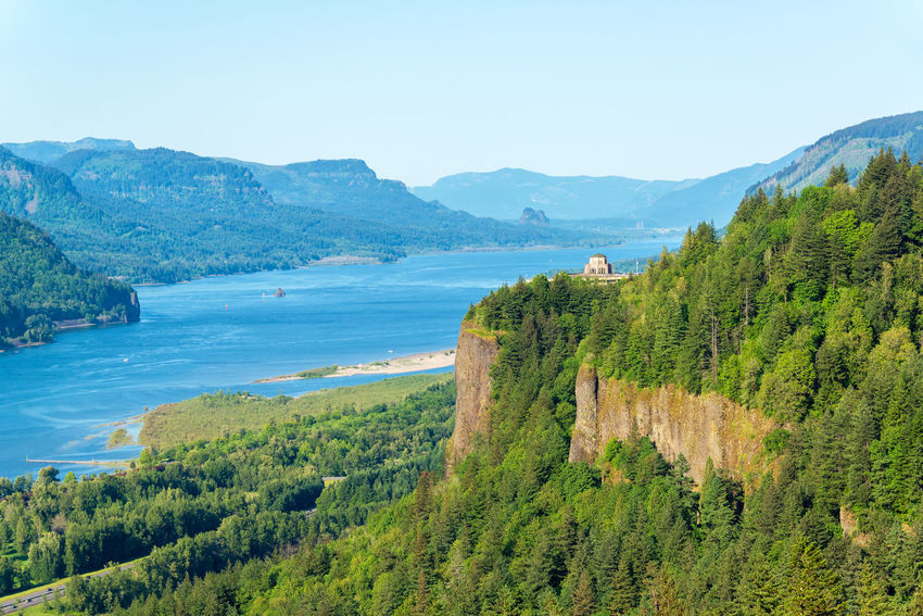 Looking down the Columbia River Gorge with Vista House visible on the hill Beauty In Nature Canyon Columbia Columbia River Columbia River Gorge Crown Point Day Forest Gorge Green Green Color Idyllic Landscape Oregon Outdoors Pine Pine Tree Pine Trees Remote River Scenics Sky Tree Trees Vista House