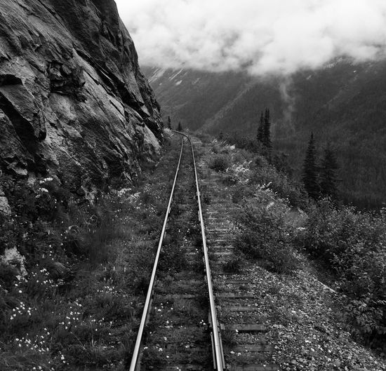 Traveling Yukon Alaska Nature Adventure Railroad Track Precarious Mountains Moutains In The Mist