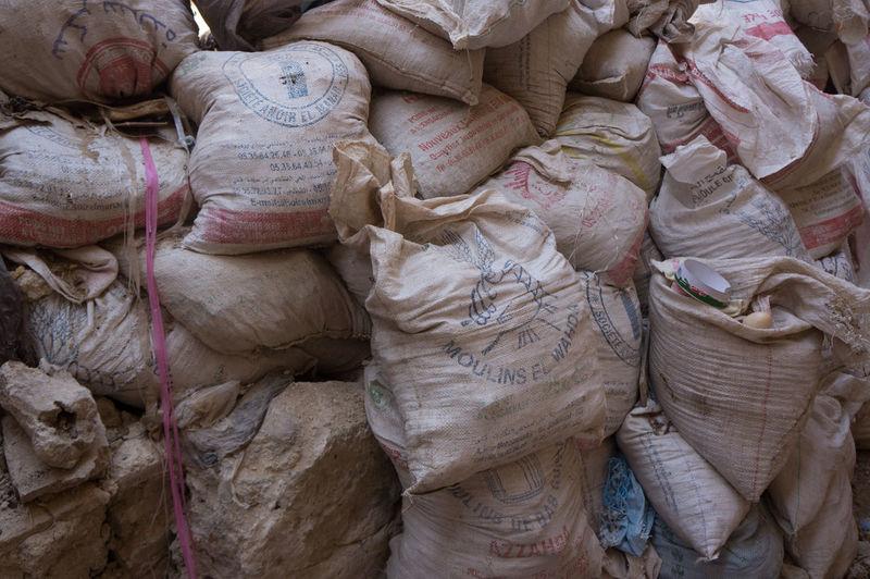 Full Frame Shot Of Sacks In Warehouse