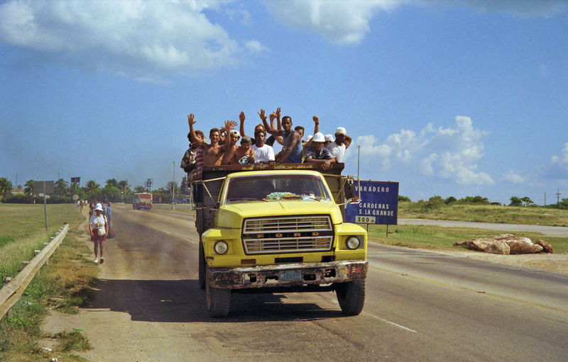 No such thing as a driver only vehicle in Cuba, locals fill up a big truck Locals Cloud - Sky Cuba Deisel Fumes Havana Journey Land Vehicle Lorry Outdoors Transportation Truck Cuban