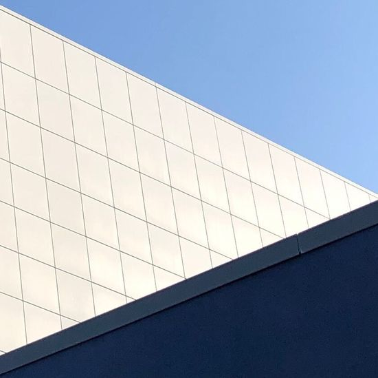 What's the point? Exterior Wall Triangles Tiles Architecture Triangle Low Angle View Architecture Built Structure Building Exterior Clear Sky Sky Blue