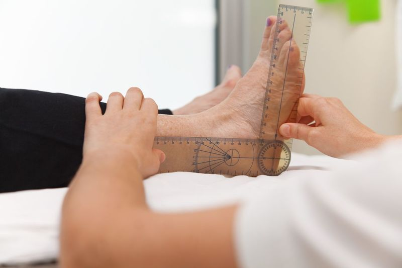 Doctor or physiotherapist measuring active range of motion using manual goniometer Physiotherapy Measuring Range Health Functional Foot Flexion Flexibility Examination Diagnosis Degree Clinic Checking Angle Mature Adult Doctor  Goniometer Phisicaltherapy Human Hand Hand Human Body Part Indoors  Real People Body Part Holding Women Adult Lifestyles Focus On Foreground Human Foot