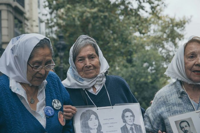 """The Mothers of Plaza de Mayo during Argentina's National Day of Memory for Truth and Justice, which is a public holiday that commemorates all those who lost their lives or otherwise suffered under the National Reorganization Process, a military dictatorship that seized power in Argentina on March 24, 1976. The junta held power for eight years, and in that time, at least 30,000 citizens were kidnapped, tortured, and executed for their political views. Many of those detained by the secret police were never heard from again, nor were their bodies ever found. Even after democracy was restored, amnesty laws and pardons ruled out trials of those behind the atrocities for several years. The Day of Memory for Truth and Justice is meant not only as a day to remember the dead, but also as a day to continue to seek justice for the human rights violations that were committed during the years of military rule. In March 2015, the 30th anniversary of the coup, there were vigils to remember the dead and missing, as well as demonstrations calling for prosecution of the perpetrators. In Buenos Aires, President Nestor Kirchner unveiled a plaque in 2006 bearing the words """"Never Again."""" Photographs of some 3,500 of the victims were displayed, and plaques bearing the names of the dead and the missing were unveiled around the city. In Buenos Aires and around the country, art exhibitions, poetry readings, prayer services, rallys, and other cultural events are dedicated to remembering the events of March 24 and its aftermath. Photos That Will Restore Your Faith In Humanity Capture The Moment Old But Awesome Photojournalism Collected Community RePicture Motherhood argentina Untold Stories Love Without Boundaries What We Revolt Against The Photojournalist - 2016 EyeEm Awards"""