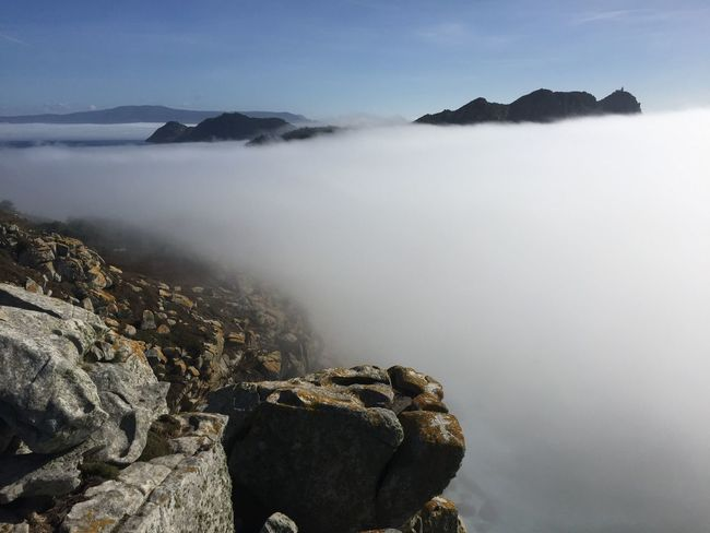Beauty In Nature Rock Scenics - Nature Mountain Tranquil Scene Water Tranquility Solid Fog Rock - Object Sky No People Nature Non-urban Scene Day Idyllic Environment Sea Mountain Range Outdoors Hazy  Mountain Peak Foggy Weather Island